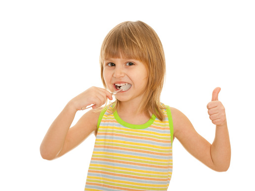 Little girl brushes teeth